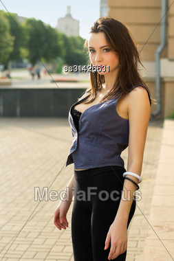 Alluring Young Caucasian Woman In Tight Leggings Posing Outdoors Stock Photo