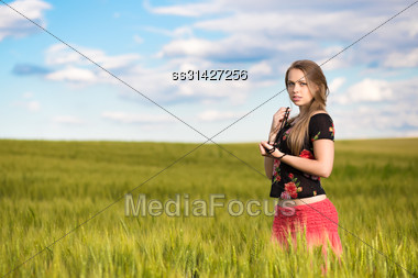 Alluring Young Lady Posing On The Wheat Field Stock Photo