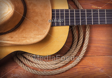 American Country Music With Guitar And Cowboy Hat And Rope Stock Photo