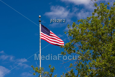 American Flag Waving In The Gentle Breeze Stock Photo
