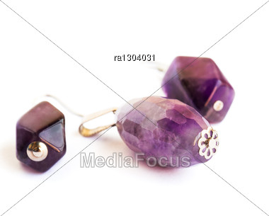 Amethyst Earrings And Medallion Isolated On White Background. Stock Photo