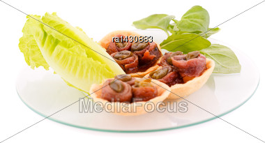 Anchovies In Pastries, Lettuce And Basil On Plate Isolated On White Background Stock Photo