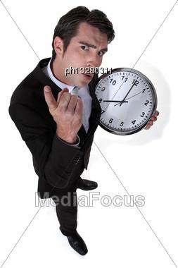 Angry Boss Holding Clock Stock Photo