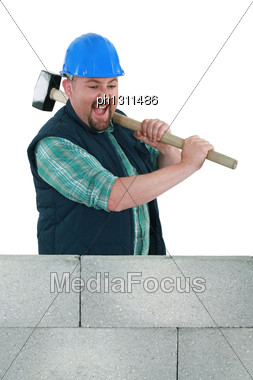 Angry Builder About To Smash Wall Stock Photo