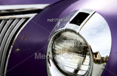 Antique Car Headlight With Purple Paint And Chrome Stock Photo
