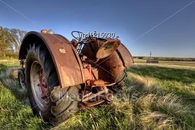 Antique Farm Equipment Sunset Saskatchewan Canada Stock Photo
