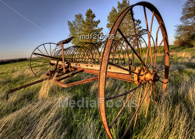 Antique Farm Equipment Sunset Saskatchewan Canada Stock Photo