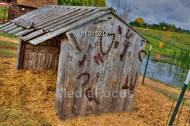 Antique Farm Tools Hanging On The Wall Of An Old Shed In High Dynamic Range Stock Photo