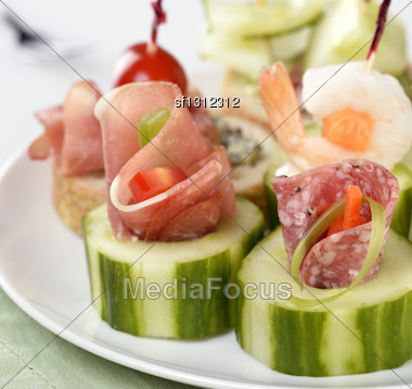 Appetizers With Smoked Meat ,Seafood And Vegetables Stock Photo