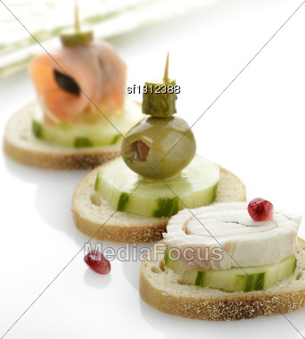 Appetizers With Vegetables,Salmon And Rolled Mozzarella Cheese Stock Photo