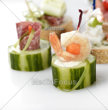 Appetizers With Vegetables ,Seafood And Smoked Meat Stock Photo