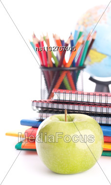 Apple, Notebook Stack And Pencils. Schoolchild And Student Studies Accessories. Back To School Concept Stock Photo