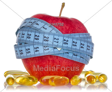 Apple Wrapped By Measuring Tape And Fish Oil Pills On White Background Stock Photo