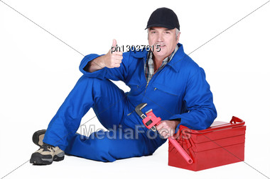 Approving Tradesman Posing With His Tools Stock Photo