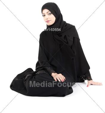 Arab Woman Sitting On The Floor Stock Photo