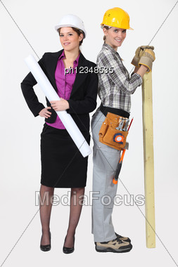 Architect And Her Carpenter. Stock Photo
