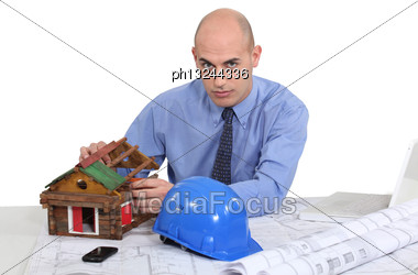 Architect Building A Cabin Stock Photo