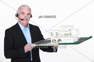 Architect Holding Replica Of Housing Stock Photo
