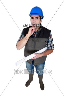 Architect Holding Rolled-up Plans Stock Photo