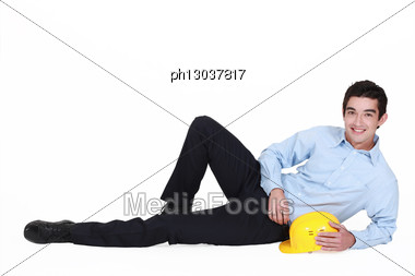 Architect Laying In Floor Stock Photo