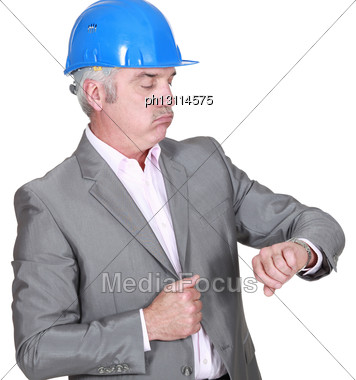 Architect Looking At His Watch Stock Photo