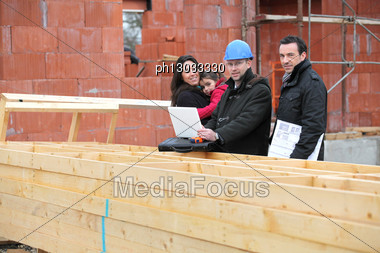 Architect Showing Plans To Customer Stock Photo
