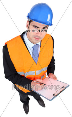 Architect Stood With Clipboard Stock Photo