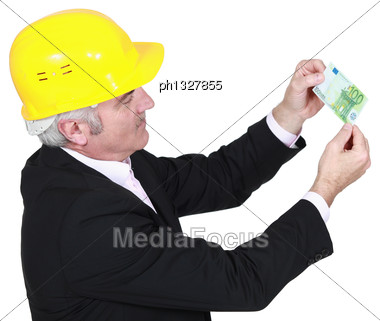 Architect With A 100 Euro Banknote Stock Photo