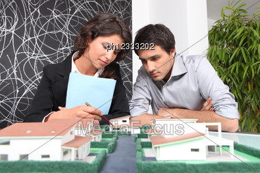 Architects Examining A Model Stock Photo