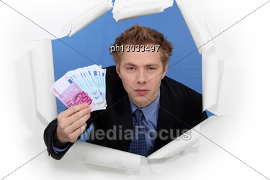 Arrogant Businessman Successfully Breaking Into A Market Stock Photo