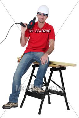Arrogant Handyman Posing Stock Photo