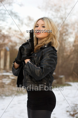 Arrogant Pretty Woman With A Gun In Winter Forest Stock Photo