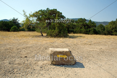 Arrow On A Stone, Specifying A Direction In Mountains Stock Photo