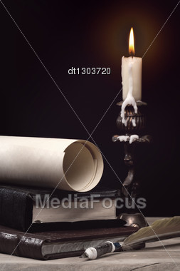Art Still Life With Burning Candle Over Old Wooden Desk Stock Photo