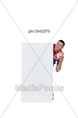 Artisan Holding Moneybox Stock Photo