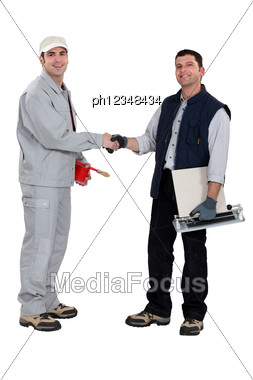 Artisans Hand In Hand Stock Photo