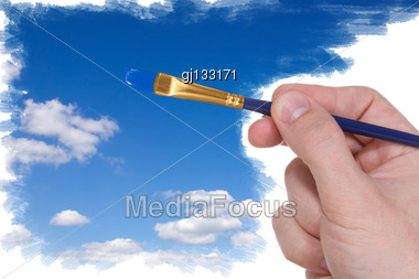 Artist Brush Painting Blue Sky With Clouds Stock Photo