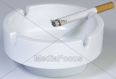 Ashtray with Cigarette Stock Photo