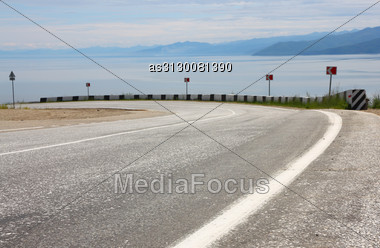 Asphalt Road And Sky With Clouds Stock Photo