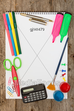 Assorted School Supplies On The Wooden Background Stock Photo