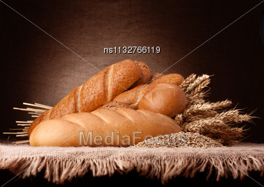 Assortment Of Breads And Ears Bunch Still Life On Rustic Background Stock Photo