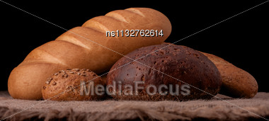 Assortment Of Breads Still Life On Rustic Background Stock Photo
