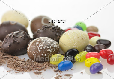 Assortment Of Chocolate Eggs And Candies Close Up Stock Photo