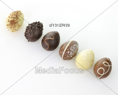 Assortment Of Chocolate Eggs On White Background Stock Photo