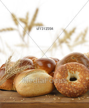 Assortment Of Bread On A Cutting Board Stock Photo