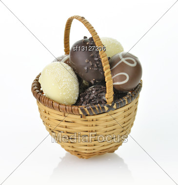 Assortment Of Chocolate Eggs In A Basket Stock Photo