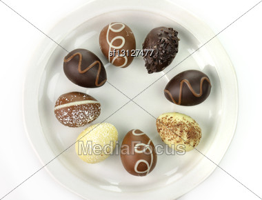 Assortment Of Chocolate Eggs On A Plate Stock Photo