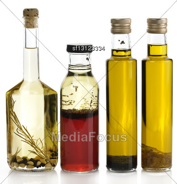 Assortment Of Cooking Oil With Spices Stock Photo