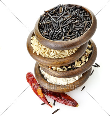 Assortment Of Rice In Wooden Bowls Stock Photo