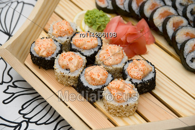 At Restaurant: Set Of Sushi On Wood Plate Stock Photo